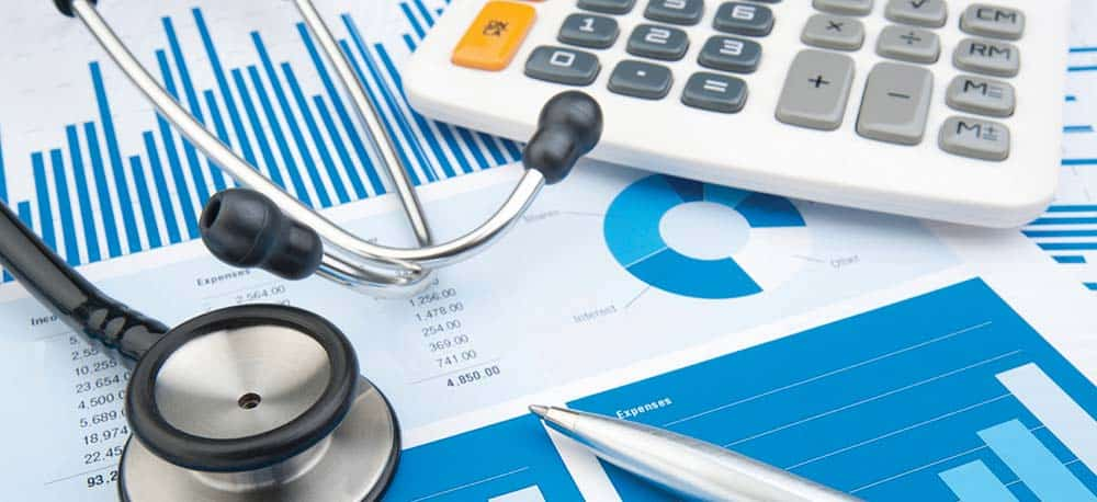 stethoscope, calculator and financial documents